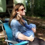 Woman Breastfeeding in Campsite