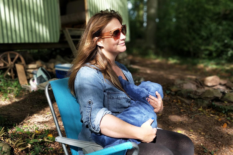 Woman Breastfeeding in Campsite