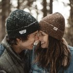 Couple in Woods Rubbing Noses
