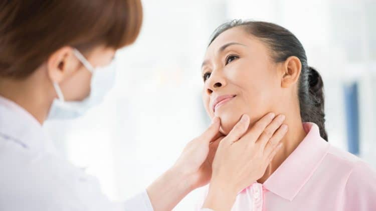 woman-getting-thyroid-checked-