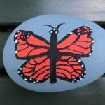 Rock painted with a butterly