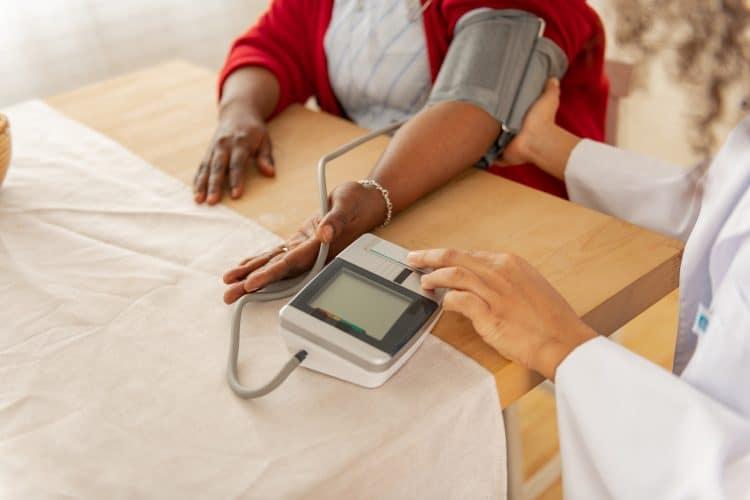 a woman having her blood pressure taken