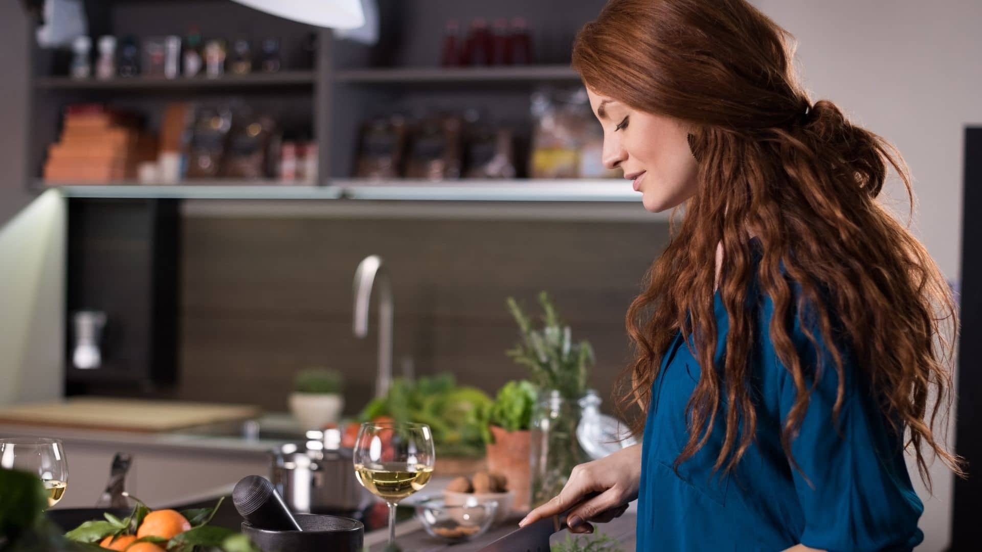 red-haired woman cooking with white wine
