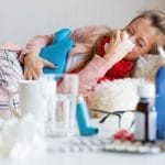 woman on couch with flu or covid 19?