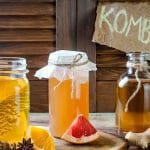 three containers of kombucha