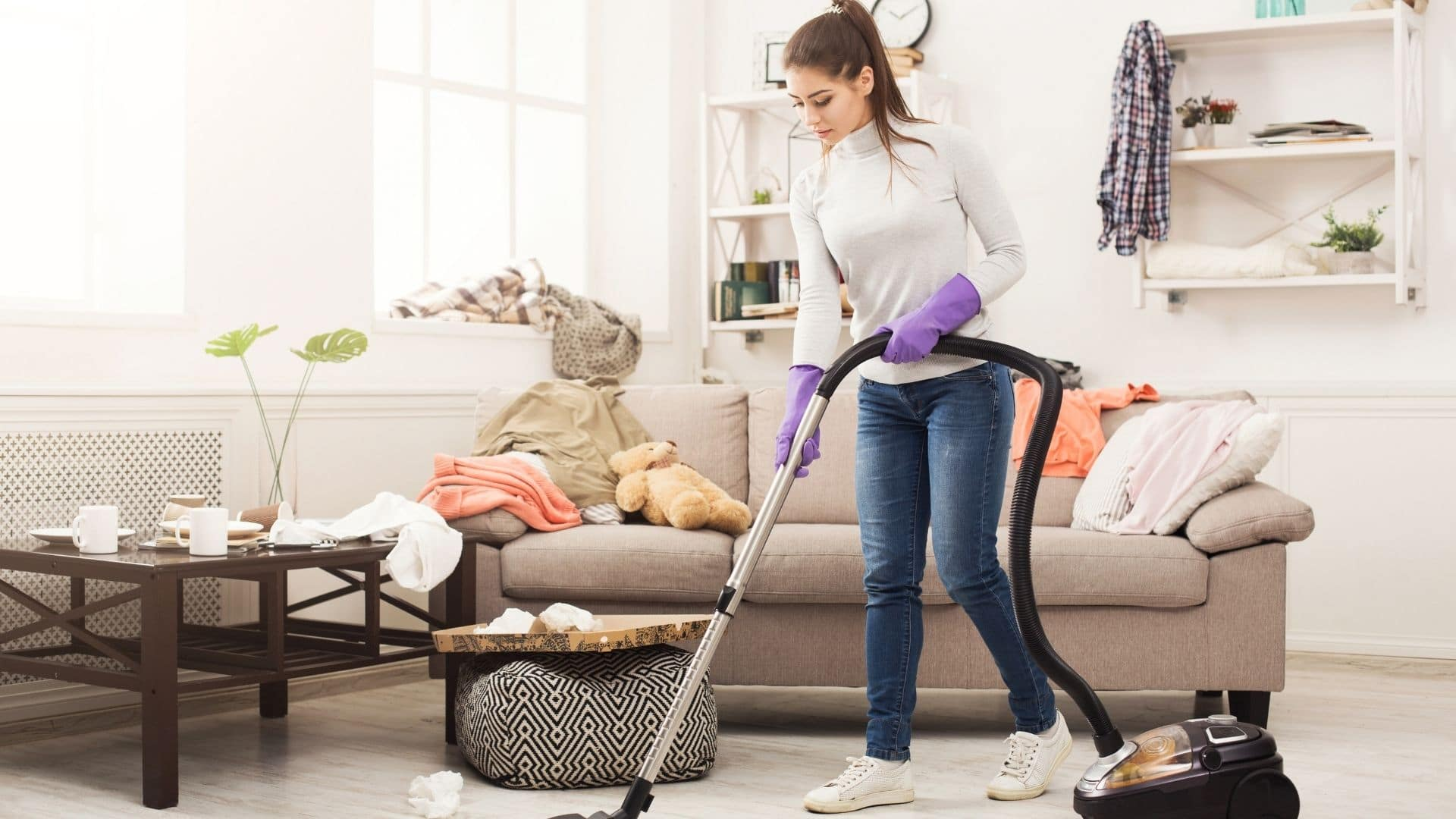 woman housecleaning with vacuum to prevent allergies