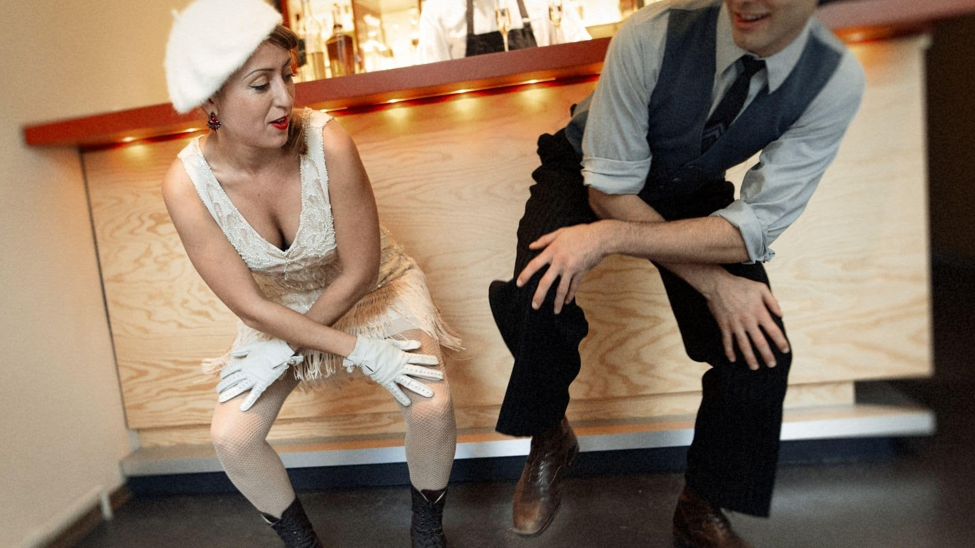 a modern couple dressed vintage doing the charleston dance