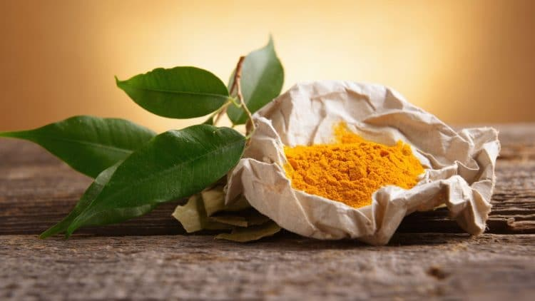 sack of tumeric powder on a wooden table