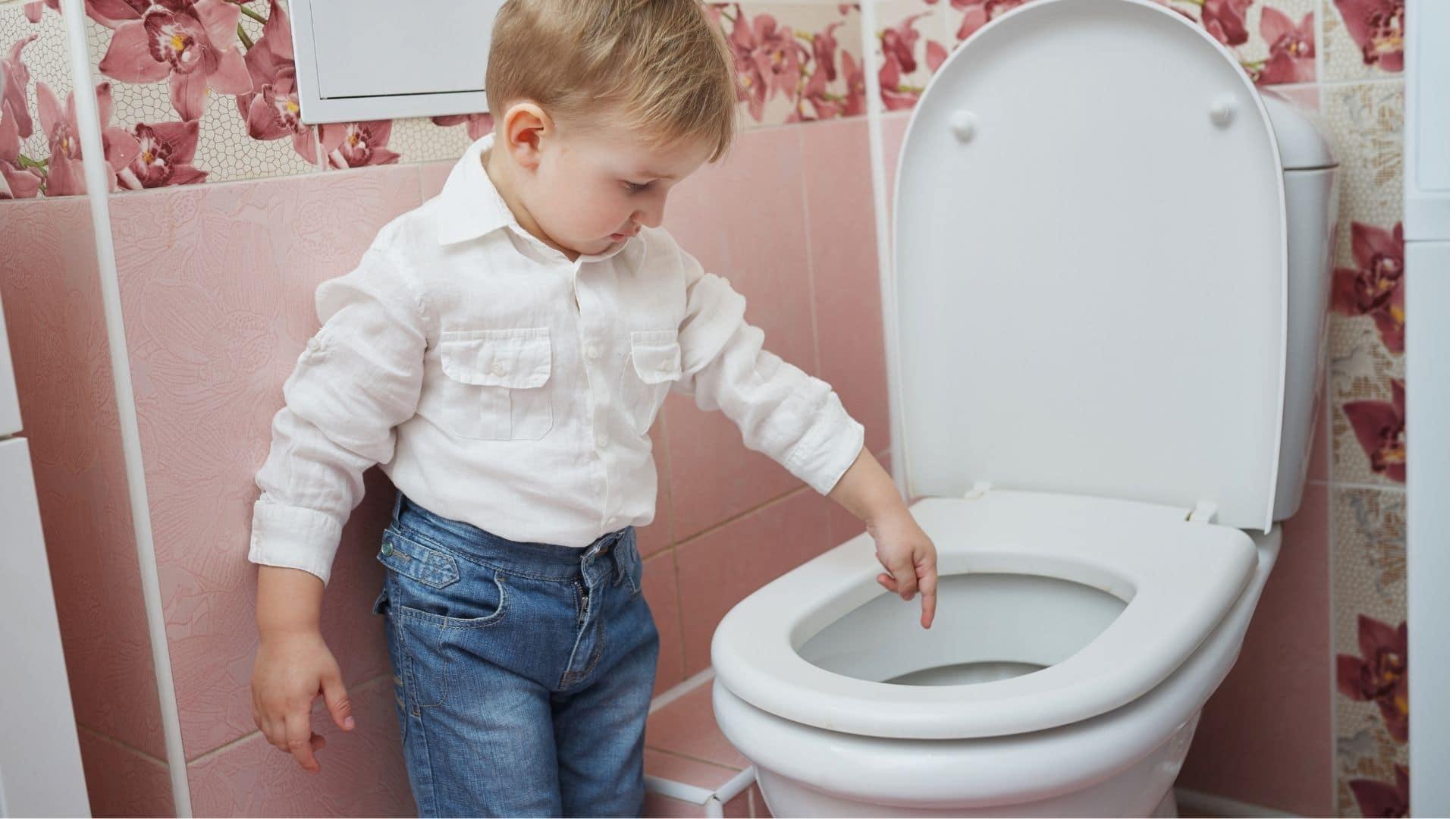 toddler pointing inside toilet