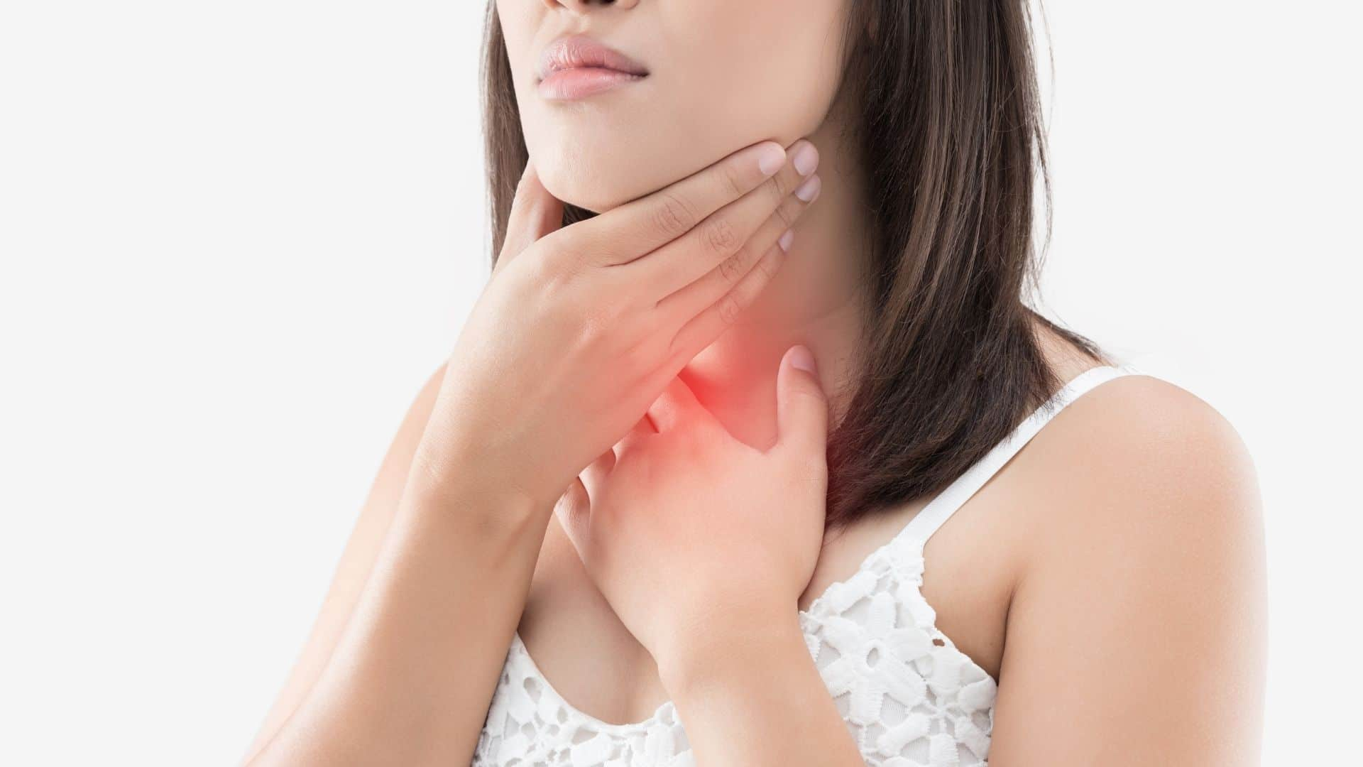 woman holding her throat with a red spotlight because of pain
